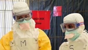 des-volontaires-de-msf-s-entrainent-avant-d-aller-en-afrique-traiter-des-malades-du-virus-ebola-a-bruxelles-le-1er-octobre-2014_5123020