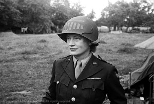 Lee Miller in steel helmet specially designed for using a camera, Normandy, France 1944 by unknown photographer Photographer Unknown © The Penrose Collection, England 2015. All rights reserved.